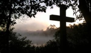cross in mist